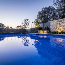 swimming pool lighting stone wall