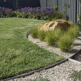 grasses, sandstone rock water feature turf