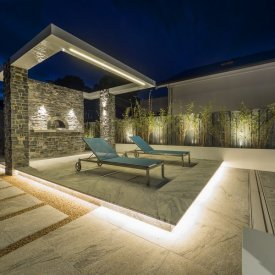 granite paving cantilevered pergola bulkhead LED lighting